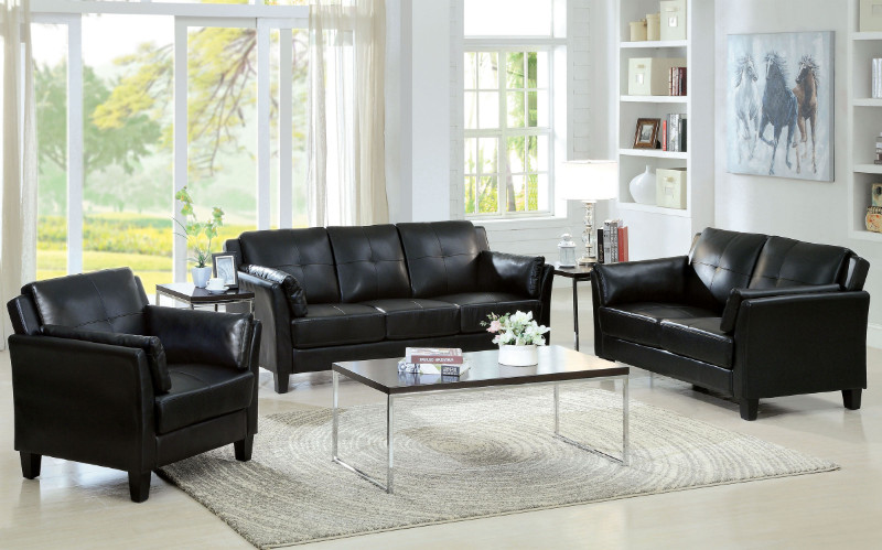 "2 pc pierre black leatherette sofa and love seat set.  This set features a leatherette upholstery with tufted seats and backs and a flared arm design.  Sofa measures 76 3/4"" x 34 1/4"" x 33 1/4"" H .  Love seat measures 57"" x 34 1/4"" x 33 1/2"" H .  Chair av"