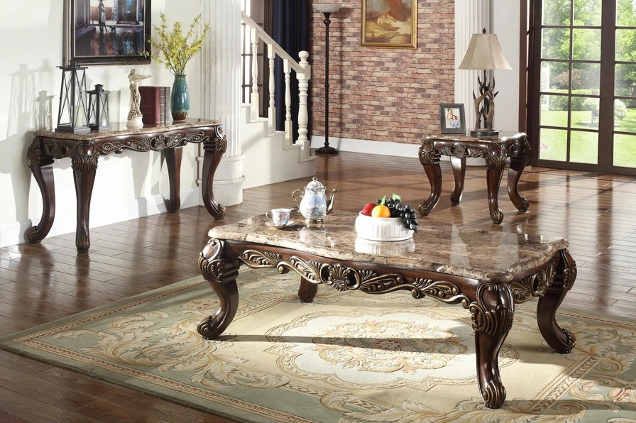 """Mc Ferran T5190  Bridgette marble top coffee table with carved accent wood trims.  Coffee table measures 56"""" x 31"""" x 20"""" H.  End table available separately and measures 26"""" x 26"""" x 25"""" H.  Sofa table available separately and measures 56"""" x 20"""" x 30"""" H."""