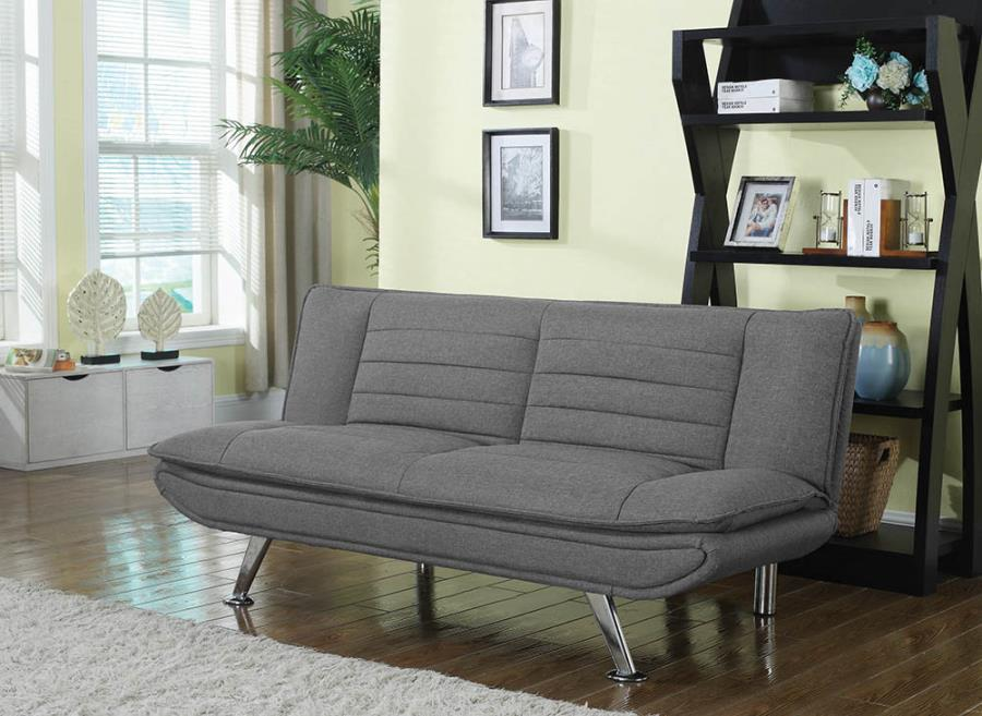 Grey woven fabric upholstered folding sofa / futon bed with tufted accents