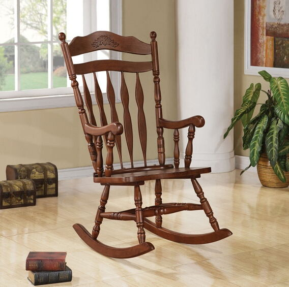 Dark walnut finish wood turned post and carved back press back rocking chair