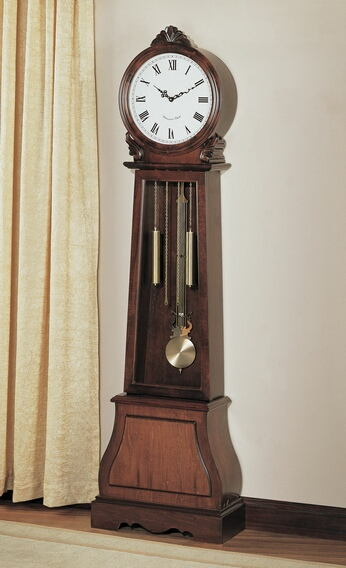 Brown finish wood grandfather clock with decorative crown and round face