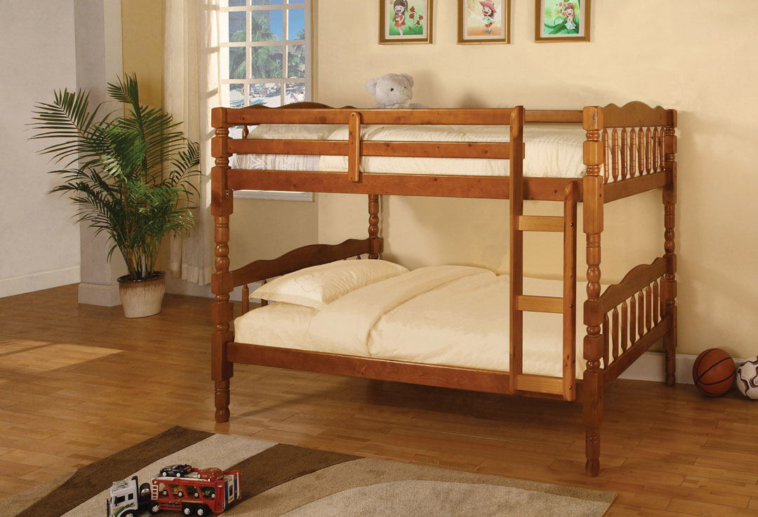 Catalina i  oak wood finish country style twin over twin bunk bed with a fixed front access ladder