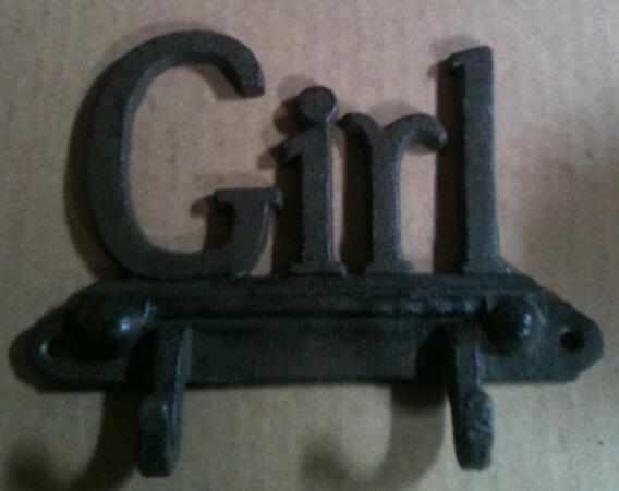 Cast iron girl wall hanger
