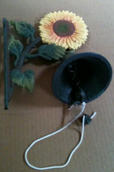 Cast iron sunflower bell wall hanger
