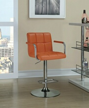 Retro style chrome finish metal and pumpkin tufted vinyl upholstered adjustable barstool with foot rest