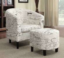 Off white french script patterned fabric upholstered barrel back arm chair and ottoman