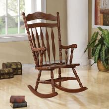 600187 Dark walnut finish wood turned post and carved back press back rocking chair
