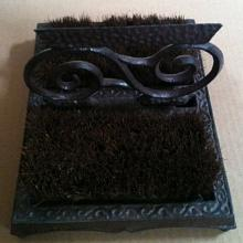 Cast iron swurll shoe brush