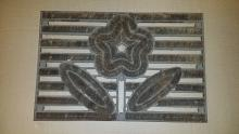 "Cast iron door mat with flower design 25"" wide x 16 1/2"" tall"